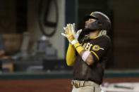 San Diego Padres' Fernando Tatis Jr., celebrates his three-run home run as he crosses the plate in the seventh inning of a baseball game against the Texas Rangers in Arlington, Texas, Monday Aug. 17, 2020. The shot scored Austin Hedges and Trent Grisham (AP Photo/Tony Gutierrez)