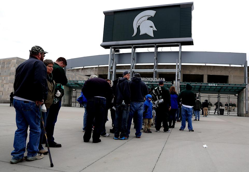 Fans line up outside Spartan Stadium before the gates opened at 12:30 pm for the 2 pm star of the Michigan State Spartans annual spring football game at Spartan Stadium in East Lansing, Michigan on Saturday, April 25, 2015.