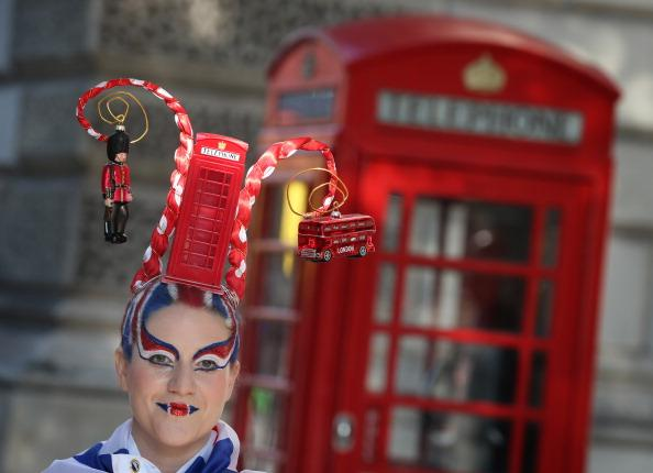 Josie Todd wears a hair sculpture depicting a London phone box on August 9, 2012 in London, England. Created by Catalonian performance artists Osadia, these sculpted hair pieces are a tribute the success of Team GB in the London 2012 Olympics and will be touring London as part of Showtime a large London outdoor arts festival. (Photo by Peter Macdiarmid/Getty Images)