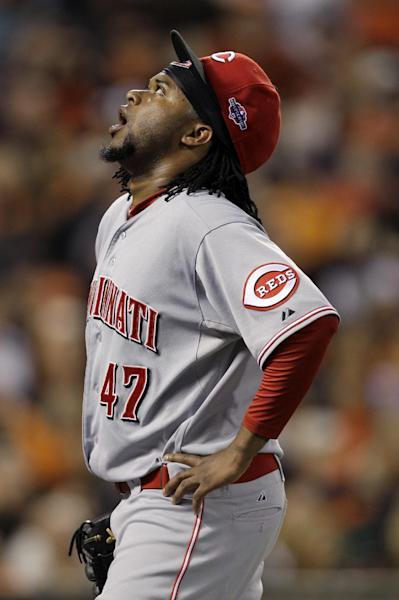 Cincinnati Reds starting pitcher Johnny Cueto looks skyward after pitching in the first inning of Game 1 of the National League division baseball series against the San Francisco Giants in San Francisco, Saturday, Oct. 6, 2012. Cueto left the game with an injury. (AP Photo/Eric Risberg)