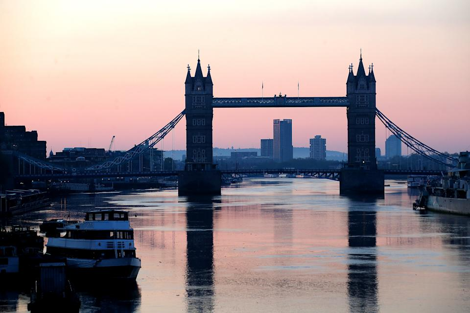 LONDON, ENGLAND - APRIL 26: A view of Tower Bridge as the sun rises on April 26, 2020 in London, England. The 40th London Marathon was due to take place today, with thousands of runners due to take part. It has postponed until October 04 due to the coronavirus (COVID-19) outbreak.  (Photo by Alex Pantling/Getty Images)