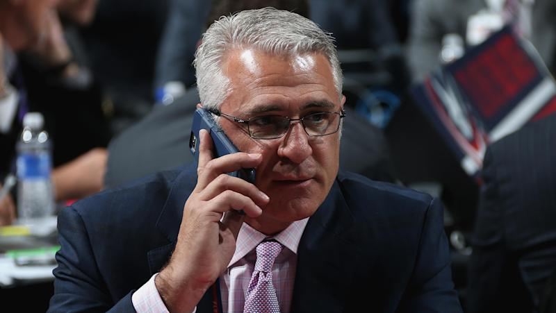 SUNRISE, FL - JUNE 27: Head Coach Ron Francis of the Carolina Hurricanes looks on from the draft table during the 2015 NHL Draft at BB&T Center on June 27, 2015 in Sunrise, Florida. (Photo by Dave Sandford/NHLI via Getty Images)