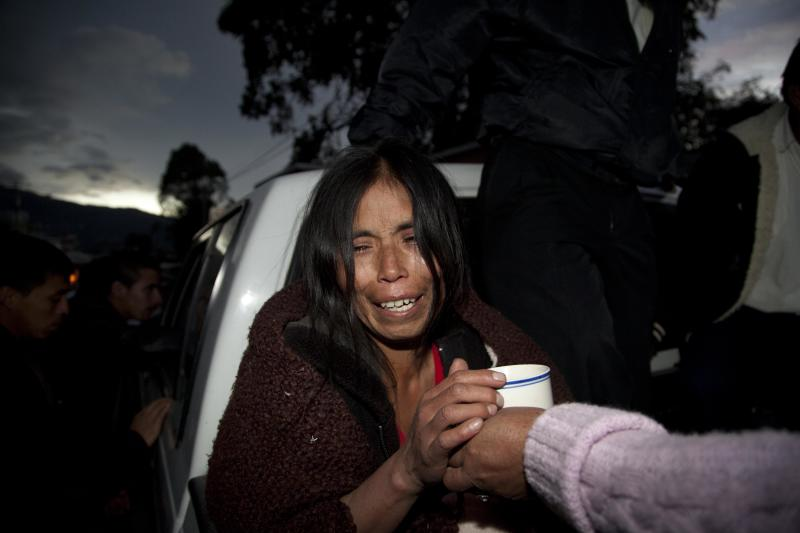 A relative of Rosa Ramos, who died in the earthquake, cries as Ramos' remains are transported from the morgue to her village in San Marcos, Guatemala, Wednesday, Nov. 7, 2012. The mountain village in the municipality of San Marcos suffered much of the damage after a 7.4-magnitude earthquake struck off the Pacific coast on Wednesday. (AP Photo/Moises Castillo)