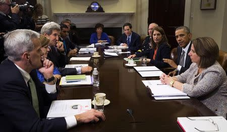 U.S. President Obama meets with members of his national security team and senior staff to receive an update on the Ebola outbreak in West Africa, at the White House in Washington