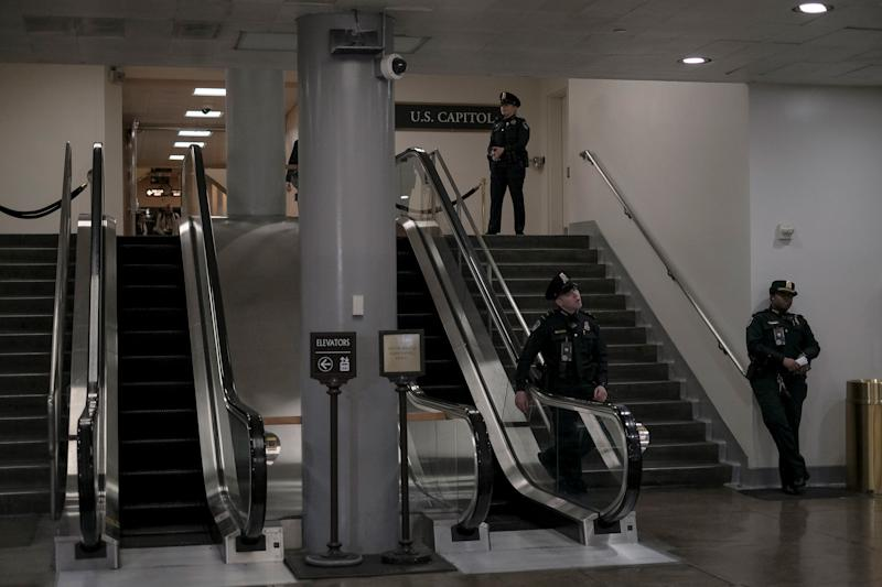 Capitol Hill police stand guard at the senate subway during the senate impeachment trial at the Capitol in Washington, D.C, on Jan. 29, 2020. | Gabriella Demczuk for TIME