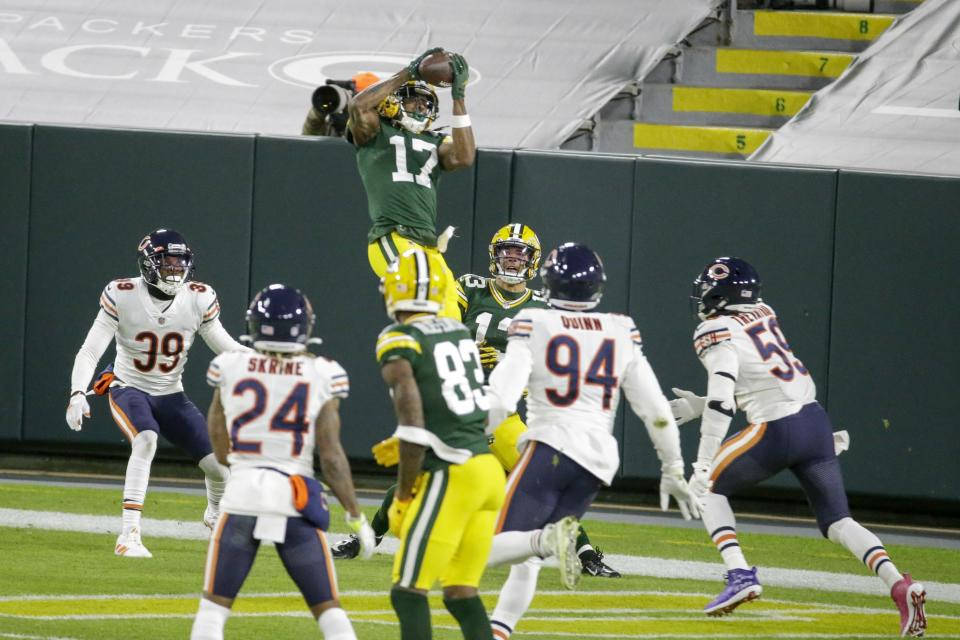 Green Bay Packers' Davante Adams catches a touchdown pass during the first half of an NFL football game against the Chicago Bears Sunday, Nov. 29, 2020, in Green Bay, Wis. (AP Photo/Mike Roemer)