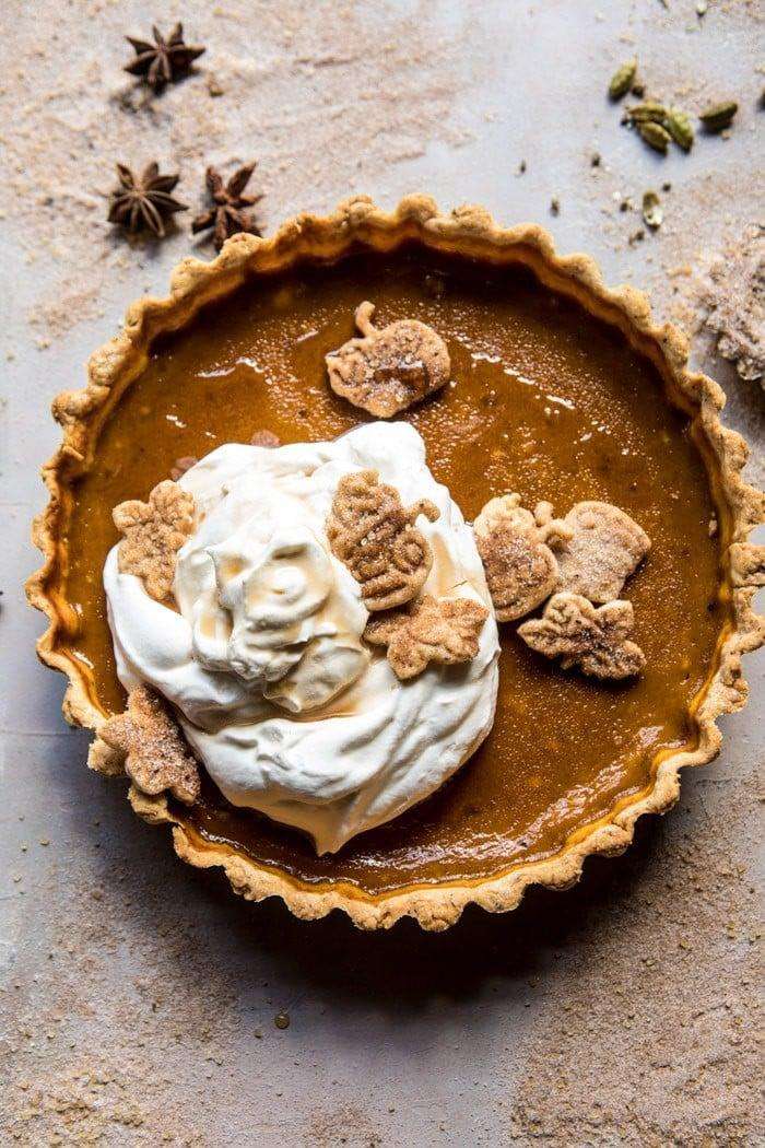 "<p>Creamy, rich, and more exciting than the traditional pumpkin pie, this chai-infused recipe will make your mouth water. Topped with maple whipped cream, you'll go back for seconds (and thirds!) of this decadent dessert.</p> <p><strong>Get the recipe</strong>: <a href=""https://www.halfbakedharvest.com/chai-pumpkin-pie-with-maple-whipped-cream/"" class=""link rapid-noclick-resp"" rel=""nofollow noopener"" target=""_blank"" data-ylk=""slk:chai pumpkin pie with maple whipped cream."">chai pumpkin pie with maple whipped cream.</a></p>"
