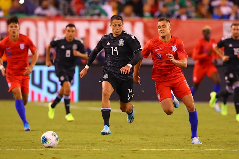 EAST RUTHERFORD, NJ - SEPTEMBER 06: Mexico forward Javier Hernandez (14) battles United States defender Aaron Long (3) during the second half of the International Friendly soccer game between the the United States and Mexico on September 6, 2019 at LetLife Stadium in East Rutherford, NJ. (Photo by Rich Graessle/Icon Sportswire via Getty Images