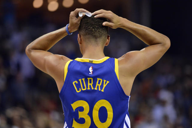 Golden State Warriors guard Stephen Curry reacts during the second half of an NBA basketball game against the Memphis Grizzlies on Saturday, Oct. 21, 2017, in Memphis, Tenn. (AP)