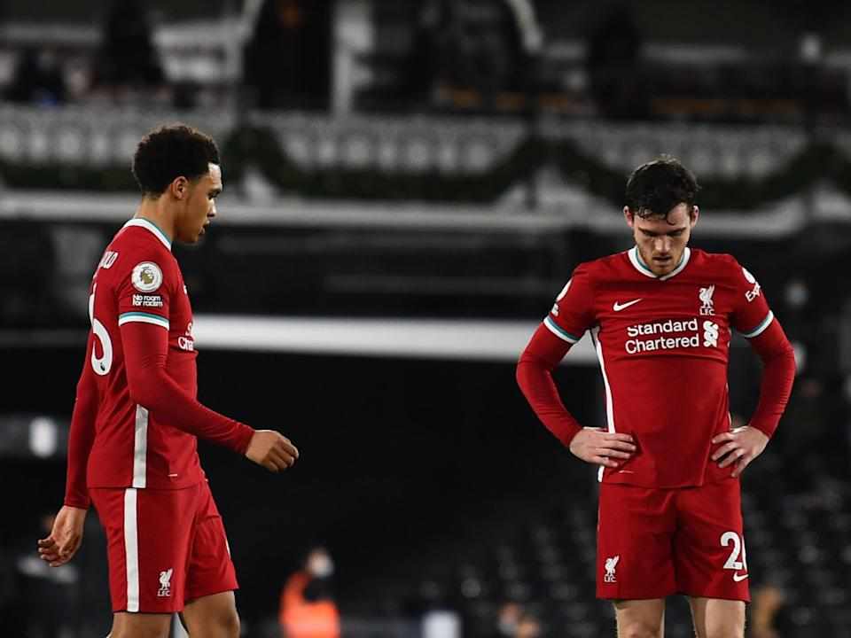 Trent Alexander-Arnold and Andrew Robertson react to their defeatLiverpool FC via Getty Images