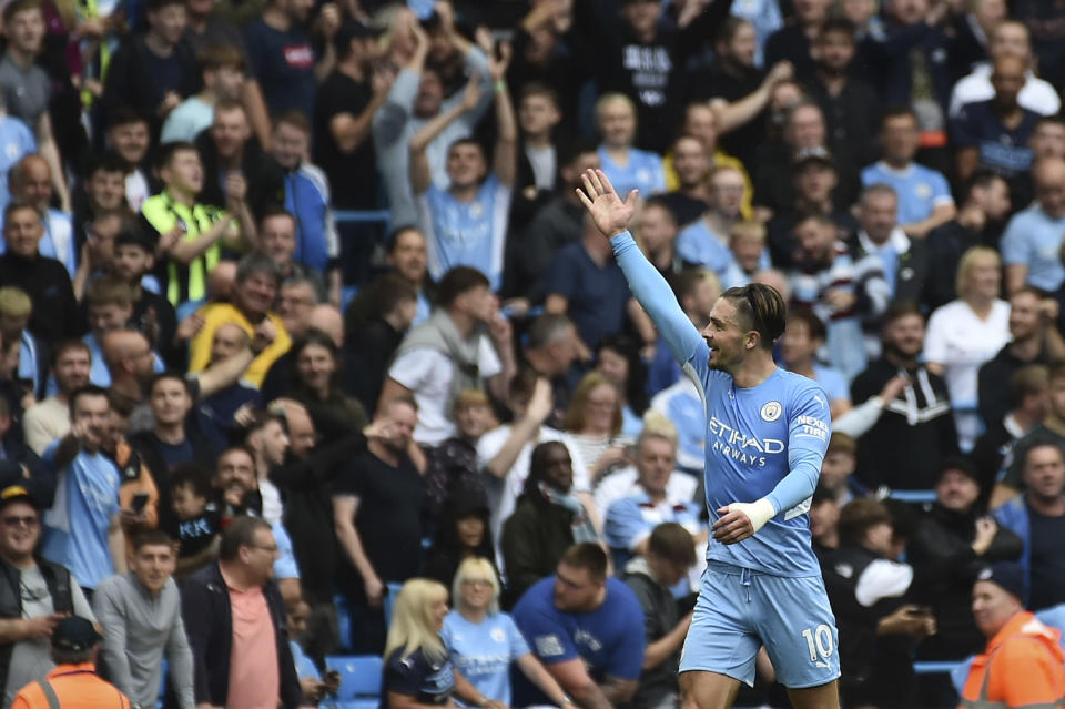 Manchester City's Jack Grealish celebrates after scoring his side's second goal during the English Premier League soccer match between Manchester City and Norwich City at Etihad stadium in Manchester, England, Saturday, Aug. 21, 2021. (AP Photo/Rui Vieira)