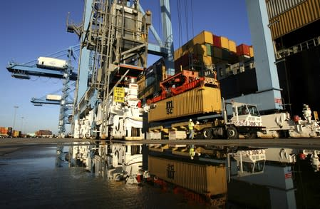 FILE PHOTO:  Crews load and unload consumer products at the Port of New Orleans along the Mississippi River in New Orleans, Louisiana