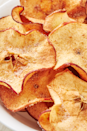"""<p>Making your own apple crisps is very easy and it's a delicious healthy snack to have on hand and not to mention, one of our favourite apple recipes. Use your favourite apple and try slicing them as thinly as you can. We like using a mandoline for even slices! The best part is that these are perfect both made in the oven or in air fryer! </p><p>Get the <a href=""""https://www.delish.com/uk/cooking/recipes/a28995950/healthy-apple-chips-recipe/"""" rel=""""nofollow noopener"""" target=""""_blank"""" data-ylk=""""slk:Apple Crisps"""" class=""""link rapid-noclick-resp"""">Apple Crisps</a> recipe.</p>"""