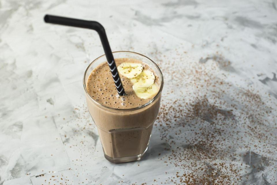 """<p>Frozen bananas are a summertime favorite, but have you ever thought to blitz them into a refreshing smoothie? Grab some milk, ice cubes, and a touch of chocolate syrup for this five-minute milkshake alternative. </p><p><em><a href=""""https://www.goodhousekeeping.com/food-recipes/a8935/chocolate-banana-smoothie-ghk/"""" rel=""""nofollow noopener"""" target=""""_blank"""" data-ylk=""""slk:Get the Chocolate-Banana Smoothie recipe »"""" class=""""link rapid-noclick-resp"""">Get the Chocolate-Banana Smoothie recipe »</a></em></p><p><strong>RELATED<em>: </em></strong><a href=""""https://www.goodhousekeeping.com/food-recipes/healthy/g4060/healthy-smoothie-recipes/"""" rel=""""nofollow noopener"""" target=""""_blank"""" data-ylk=""""slk:25 Healthy Smoothies for Breakfast"""" class=""""link rapid-noclick-resp"""">25 Healthy Smoothies for Breakfast</a><br></p>"""