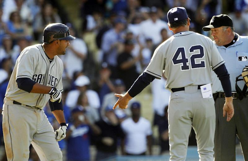 San Diego Padres' Jesus Guzman, left, and manager Bud Black talk with umpire Dale Scott after Guzman hit into a controversial triple play by the Los Angeles Dodgers in the ninth inning of a baseball game in Los Angeles Sunday, April 15, 2012. The triple play stood and Black was ejected. The Dodgers won 5-4. (AP Photo/Reed Saxon)