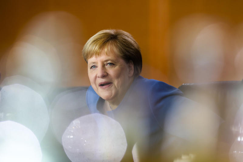 German Chancellor Angela Merkel arrives for a meeting of the called Climate Cabinet at the chancellery in Berlin, Germany, Friday, Sept. 20, 2019. The Climate Cabinet in a committee of German government ministers and advisors to develop strategies for Germany to fight the climate change. (AP Photo/Markus Schreiber)