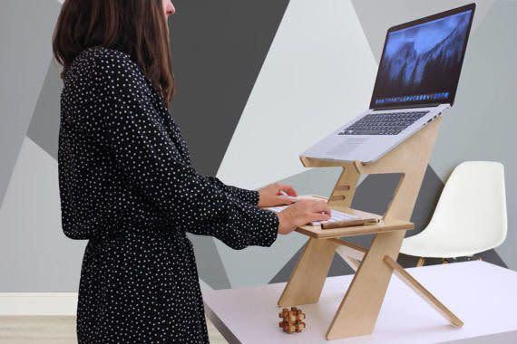 This handmade desk is made to order and customized to your height. The sleek design of this tabletop standing desk ensures it doesn't take up more of your desktop than necessary. <span>Shop it here</span>.
