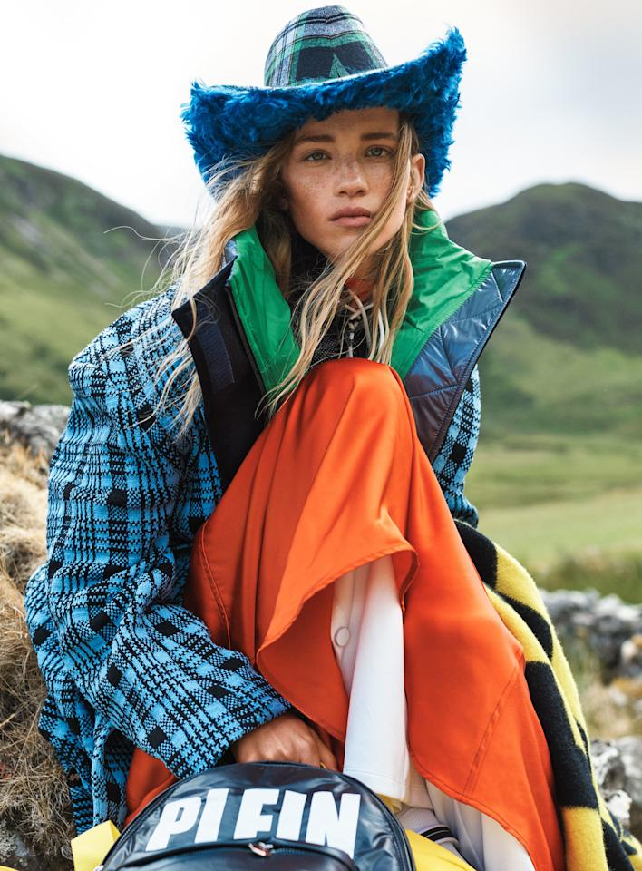 """To chase the blues away, pair a sky-hued checked coat with a faux fur–brimmed hat. Dries Van Noten coat, $2,060; <a href=""""https://www.saksfifthavenue.com/Entry.jsp"""" rel=""""nofollow"""">saksfifthavenue.com</a>. Sportmax puffer vest ($675) and dress ($1,050); Sportmax, NYC. Lizzie McQuade hat."""