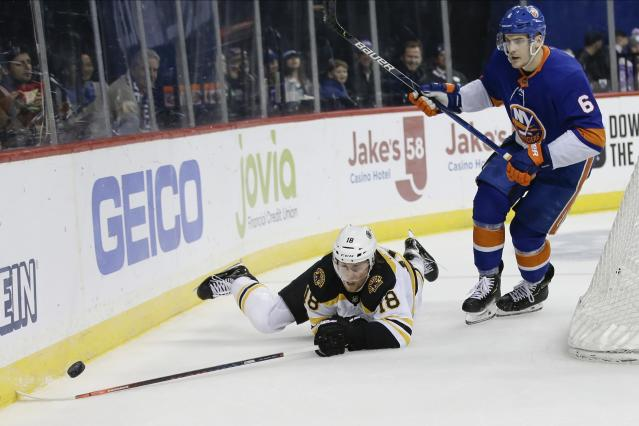 New York Islanders' Anthony Beauvillier (18) falls down while fighting for control of the puck with New York Islanders' Ryan Pulock (6) during the first period of an NHL hockey game Saturday, Jan. 11, 2020, in New York. (AP Photo/Frank Franklin II)