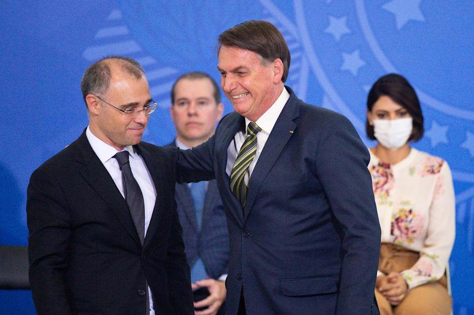 BRASILIA, BRAZIL - APRIL 29: President of Brazil Jair Bolsonaro (R) smiles with Justice Minister André Luiz Mendonça (L) during the sworn in ceremony for newly appointed Justice Minister André Luiz Mendonça and new brazilian Attorney General Jose Levi Mello amidstthe coronavirus (COVID-19) pandemic at the Planalto Palace on April, 29, 2020 in Brasilia. Brazil has over 71,000 confirmed positive cases of Coronavirus and has over 5,000 deaths. (Photo by Andressa Anholete/Getty Images)