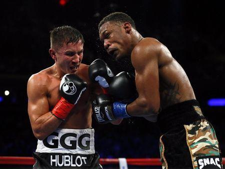 Mar 18, 2017; New York City, NY, USA; Gennady Golovkin hits Daniel Jacobs during middleweight world championship fight at Madison Square Garden. Mandatory Credit: Noah K. Murray-USA TODAY Sports