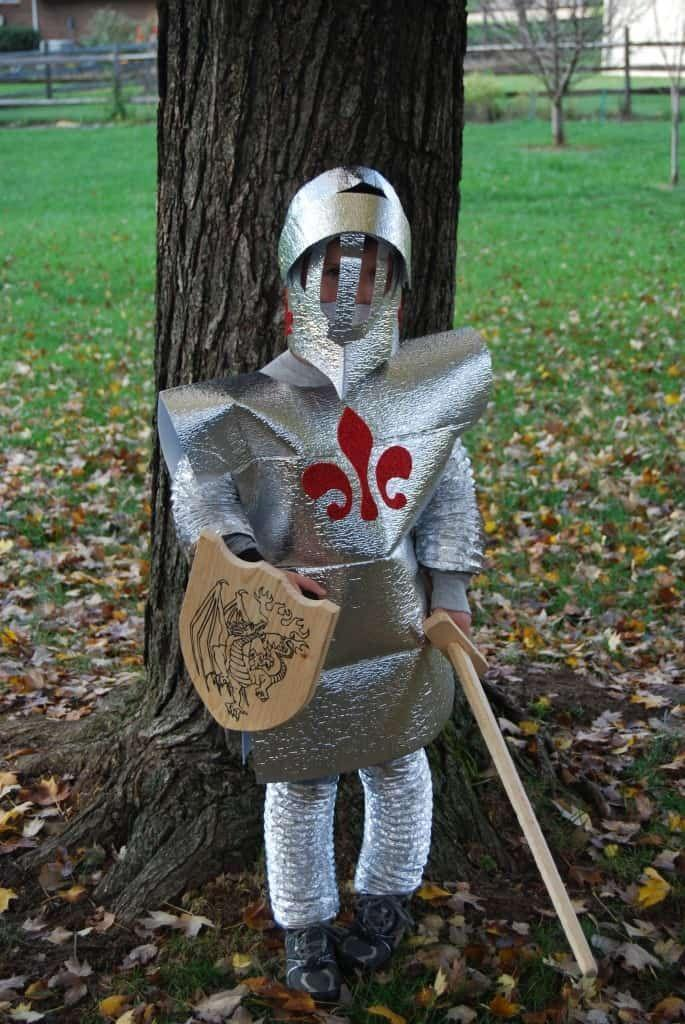 """<p>This clever costume starts with auto shades and dryer vent ducts! How creative is that?</p><p><strong>Get the tutorial at</strong> <strong><a href=""""https://savingslifestyle.com/homemade-knight-shining-armor-costume/"""" rel=""""nofollow noopener"""" target=""""_blank"""" data-ylk=""""slk:Savings Lifestyle"""" class=""""link rapid-noclick-resp"""">Savings Lifestyle</a>.</strong></p><p><a class=""""link rapid-noclick-resp"""" href=""""https://www.amazon.com/BNYD-Windshield-Sunshade-Foldable-Reflective/dp/B01JAP2M2O/ref=sr_1_6?dchild=1&keywords=silver+sun+shades+auto&qid=1592939486&sr=8-6&tag=syn-yahoo-20&ascsubtag=%5Bartid%7C10050.g.21603260%5Bsrc%7Cyahoo-us"""" rel=""""nofollow noopener"""" target=""""_blank"""" data-ylk=""""slk:SHOP SUN SHADES"""">SHOP SUN SHADES</a></p>"""