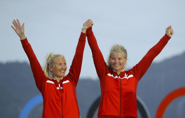 2016 Rio Olympics - Sailing - Victory Ceremony - Women's Skiff - 49er FX - Victory Ceremony - Marina de Gloria - Rio de Janeiro, Brazil - 18/08/2016. Jena Hansen (DEN) of Denmark and Katja Salskov-Iversen (DEN) of Denmark celebrate bronze medal. REUTERS/Brian Snyder FOR EDITORIAL USE ONLY. NOT FOR SALE FOR MARKETING OR ADVERTISING CAMPAIGNS.