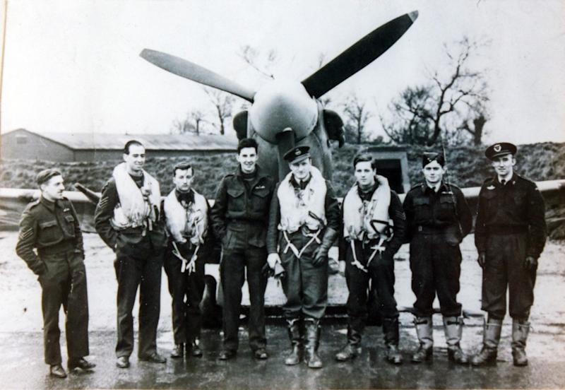 Allan Scott, third from the right, in front of a Spitfire with fellow airmen at Biggin Hill - Caters News Agency