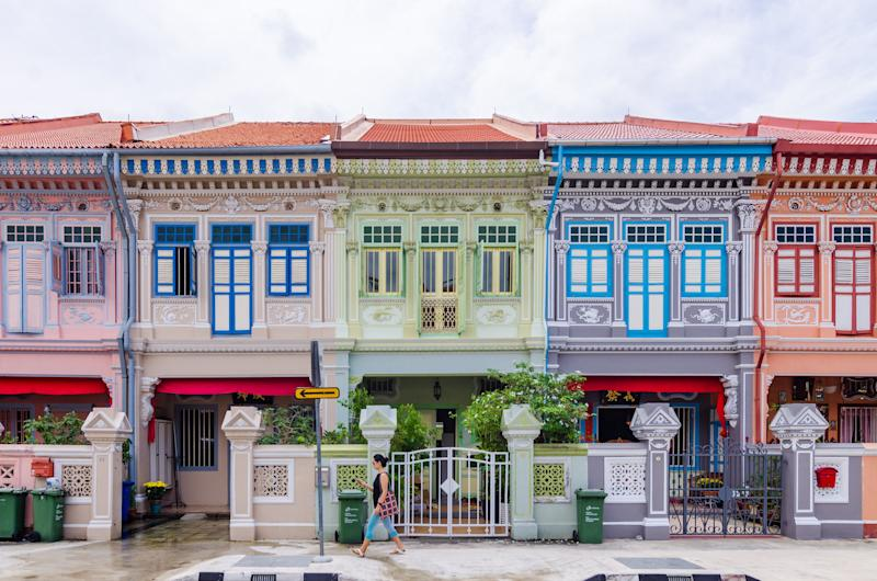 While traveling through Asia, Rachel sees Peranakan terrace houses (à la the ones pictured above on Joo Chiat Road in Singapore). The book also mentions that Astrid owns a row of historic Peranakan shop houses on Singapore's Emerald Hill.