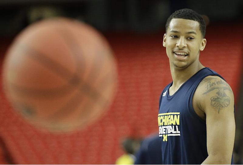 Michigan's Trey Burke watches play during practice of the NCAA Final Four tournament college basketball semifinal game against Syracuse, Friday, April 5, 2013, in Atlanta. Michigan plays Syracuse in a semifinal game on Saturday. (AP Photo/David J. Phillip)