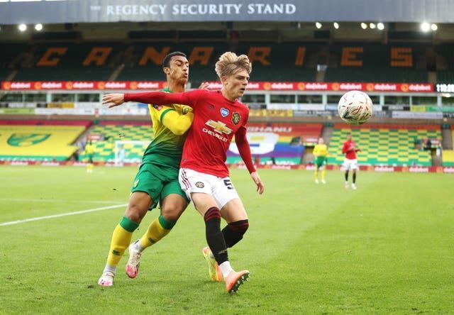 Brandon Williams (right) in action for Manchester United at Carrow Road