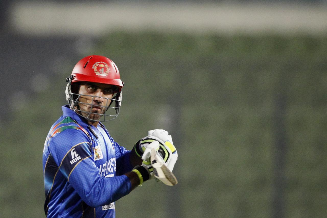 Afghanistan's Samiullah Shenwari walks back to the pavilion after his dismissal by Sri Lanka's Suranga Lakmal during the Asia Cup one-day international cricket tournament between them in Dhaka, Bangladesh, Monday, March 3, 2014. (AP Photo/A.M. Ahad)