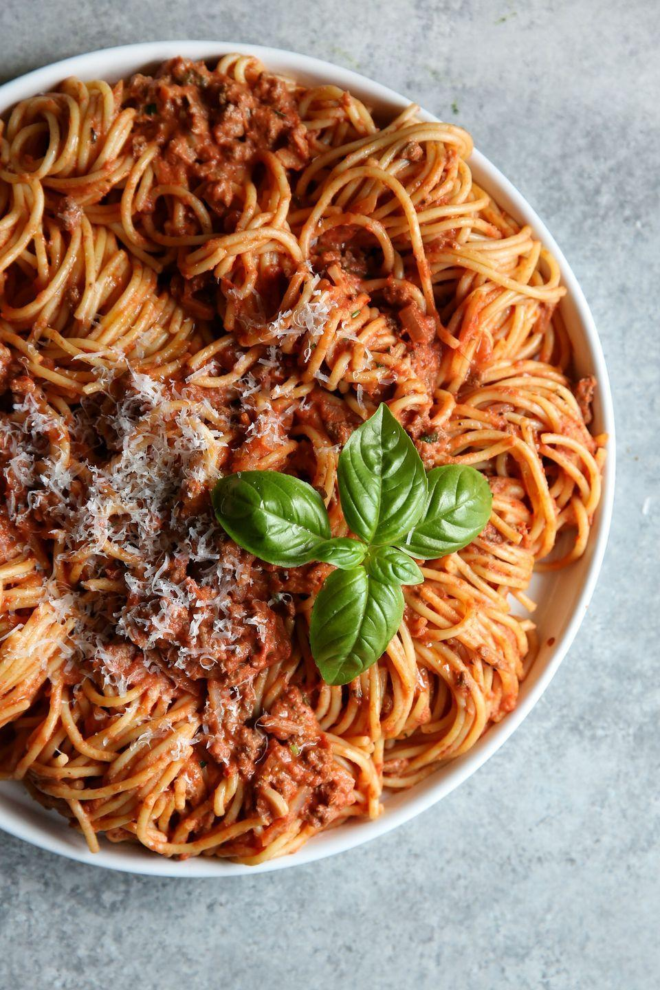 """<p>This simple meat sauce will persuade you to ditch the jarred stuff for good.</p><p>Get the recipe from <a href=""""/cooking/recipe-ideas/recipes/a47204/spaghetti-with-creamy-meat-sauce-recipe/"""" data-ylk=""""slk:Delish"""" class=""""link rapid-noclick-resp"""">Delish</a>.</p>"""