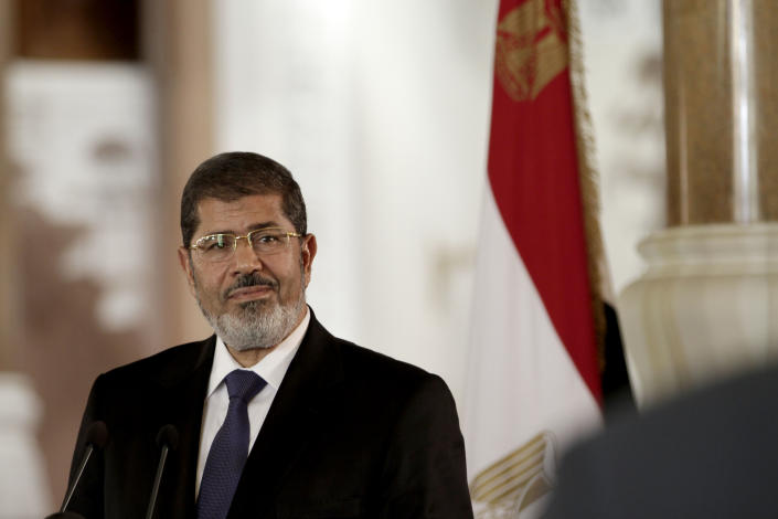 In this Friday, July 13, 2012 photo, Egyptian President Mohammed Morsi speaks to reporters during a joint news conference with Tunisian President Moncef Marzouki, unseen, at the Presidential palace in Cairo, Egypt. Egypt's president issued constitutional amendments Thursday, Nov. 22, 2012, granting himself far-reaching powers. (AP Photo/Maya Alleruzzo)