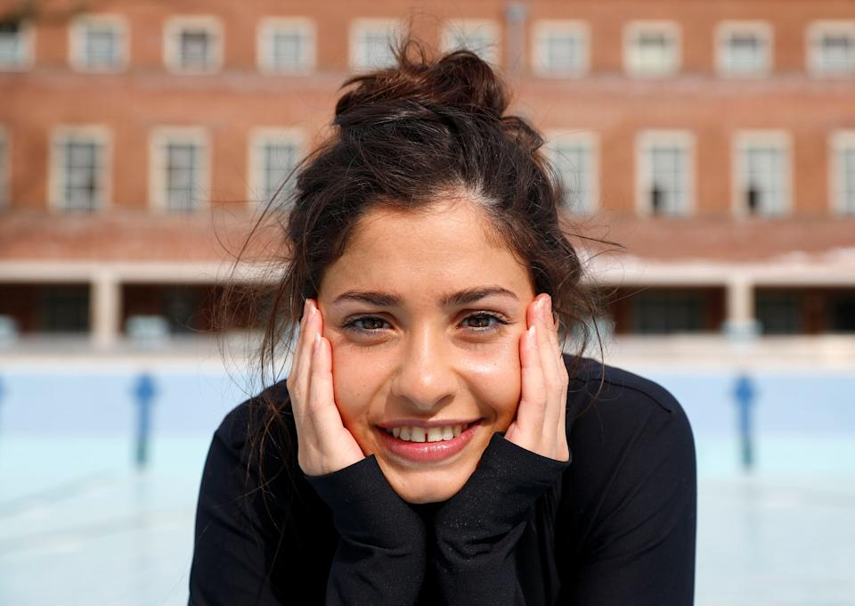 Syrian refugee and Olympic swimmer Yusra Mardini poses for the photographer after a training session in a pool at the Olympic park in Berlin, Germany, April 12, 2018. Picture taken April 12, 2018. REUTERS/Fabrizio Bensch