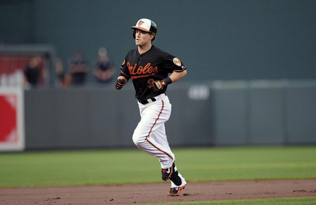 Baltimore Orioles' Nate McLouth rounds the bases after his home run during the first inning of a baseball game against the Colorado Rockies, Friday, Aug. 16, 2013, in Baltimore. (AP Photo/Nick Wass)