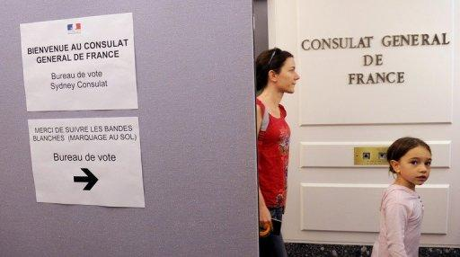 People arrive to vote at the French consulate general in Sydney as French citizens in Australia began voting on April 22, in the first round of the country's presidential election that pits Socialist Francois Hollande against incumbent Nicolas Sarkozy