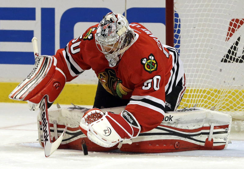 Chicago Blackhawks goalie Corey Crawford saves a shot by Los Angeles Kings center Jeff Carter during the first period in Game 5 of the NHL hockey Stanley Cup playoffs Western Conference finals, Saturday, June 8, 2013, in Chicago. (AP Photo/Nam Y. Huh)