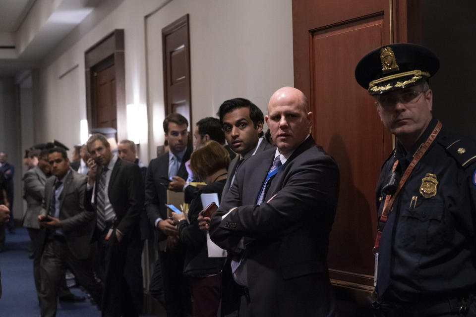 Police, press, and congressional staff wait outside a closed-door meeting between members of the House of Representatives and Vice President Mike Pence and the White House coronavirus task force, on Capitol Hill in Washington, Wednesday, March 4, 2020. (AP Photo/J. Scott Applewhite)