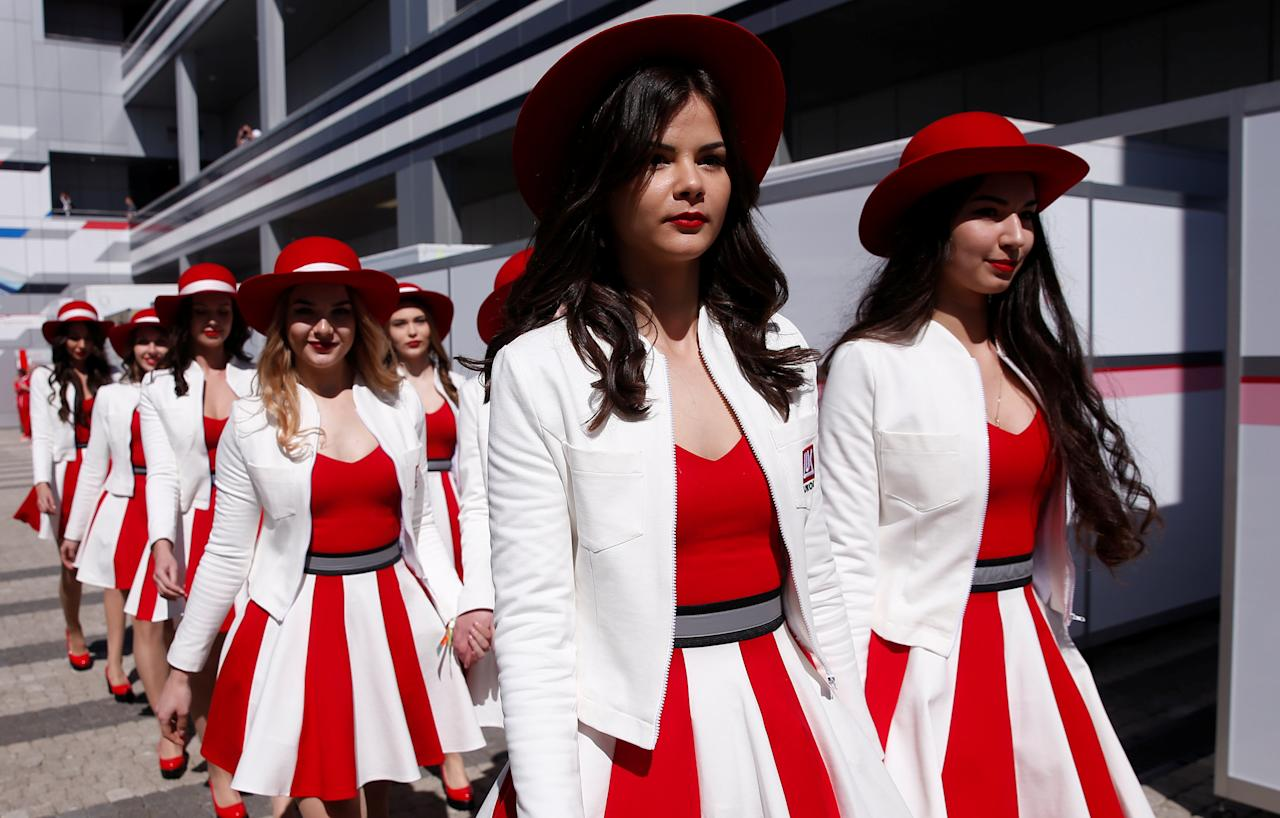 Formula One - F1 - Russian Grand Prix - Sochi, Russia - 29/04/17 - Grid girls walk in the paddock area. REUTERS/Maxim Shemetov