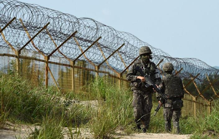 South Korean soldiers keeping watch near the scene where planted landmines exploded on August 4, maiming two soldiers on border patrol in the Demilitarized Zone (AFP Photo/South Korean Defence Ministry)