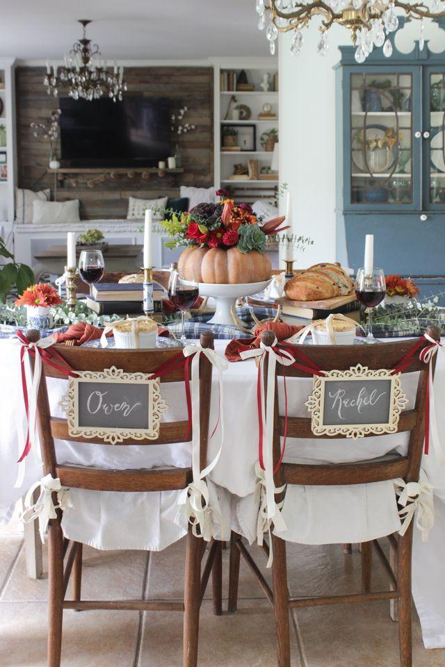 "<p>Who says you need to keep place cards on the table? Follow this blogger's lead and hang chic chalkboard placards over the backs of your guests' chairs instead.</p><p><strong>Get the tutorial at <a href=""https://www.shadesofblueinteriors.com/colorful-thanksgiving-tablescape/"" rel=""nofollow noopener"" target=""_blank"" data-ylk=""slk:Shades of Blue Interiors"" class=""link rapid-noclick-resp"">Shades of Blue Interiors</a>. </strong></p><p><strong><a class=""link rapid-noclick-resp"" href=""https://www.amazon.com/DecoArt-Americana-Chalkboard-Paint-2-Ounce/dp/B003T38FSE?tag=syn-yahoo-20&ascsubtag=%5Bartid%7C10050.g.1538%5Bsrc%7Cyahoo-us"" rel=""nofollow noopener"" target=""_blank"" data-ylk=""slk:SHOP CHALKBOARD PAINT"">SHOP CHALKBOARD PAINT</a><br></strong></p>"
