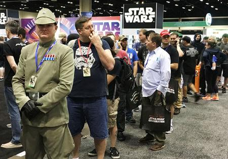 Matt Wilsen, 30, of Sarasota, stands in line waiting to grab his Luke Skywalker figure at the annual Star Wars Celebration where Walt Disney Co licensees are selling a new Luke Skywalker action figure, limited-edition Stormtrooper helmets and other coveted merchandise, in Orlando, Florida, U.S., April 14, 2017.  REUTERS/Zach Fagenson