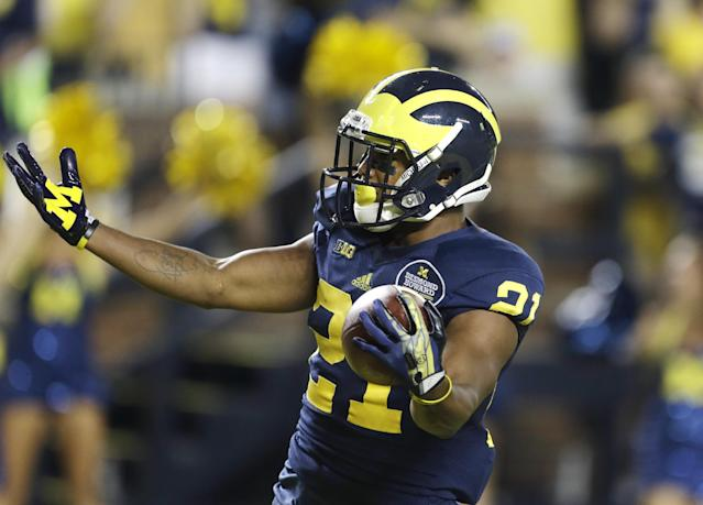 Michigan wide receiver Jeremy Gallon (21) gestures after scoring a touchdown during the first quarter of an NCAA college football game against Notre Dame in Ann Arbor, Mich., Saturday, Sept. 7, 2013. (AP Photo/Carlos Osorio)