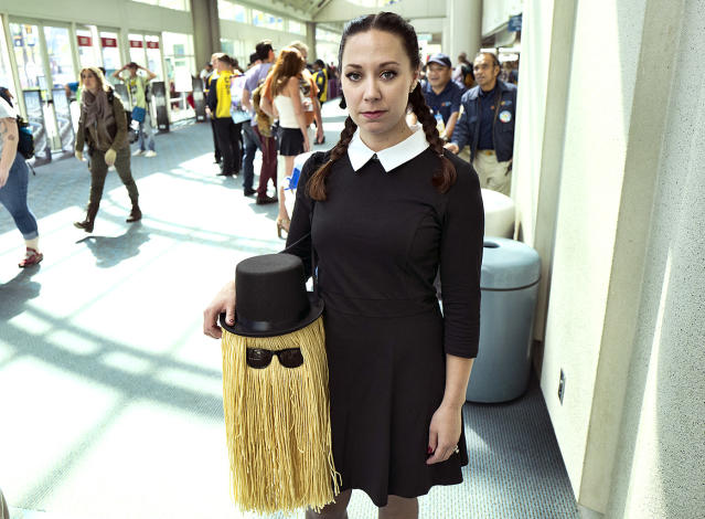 <p>Amanda Mossbarger, from San Diego, dressed as Wednesday Addams while carrying Cousin It from <em>The Addams Family</em> at Comic-Con International on July 19, 2018, in San Diego. (Photo: Richard Vogel/AP) </p>
