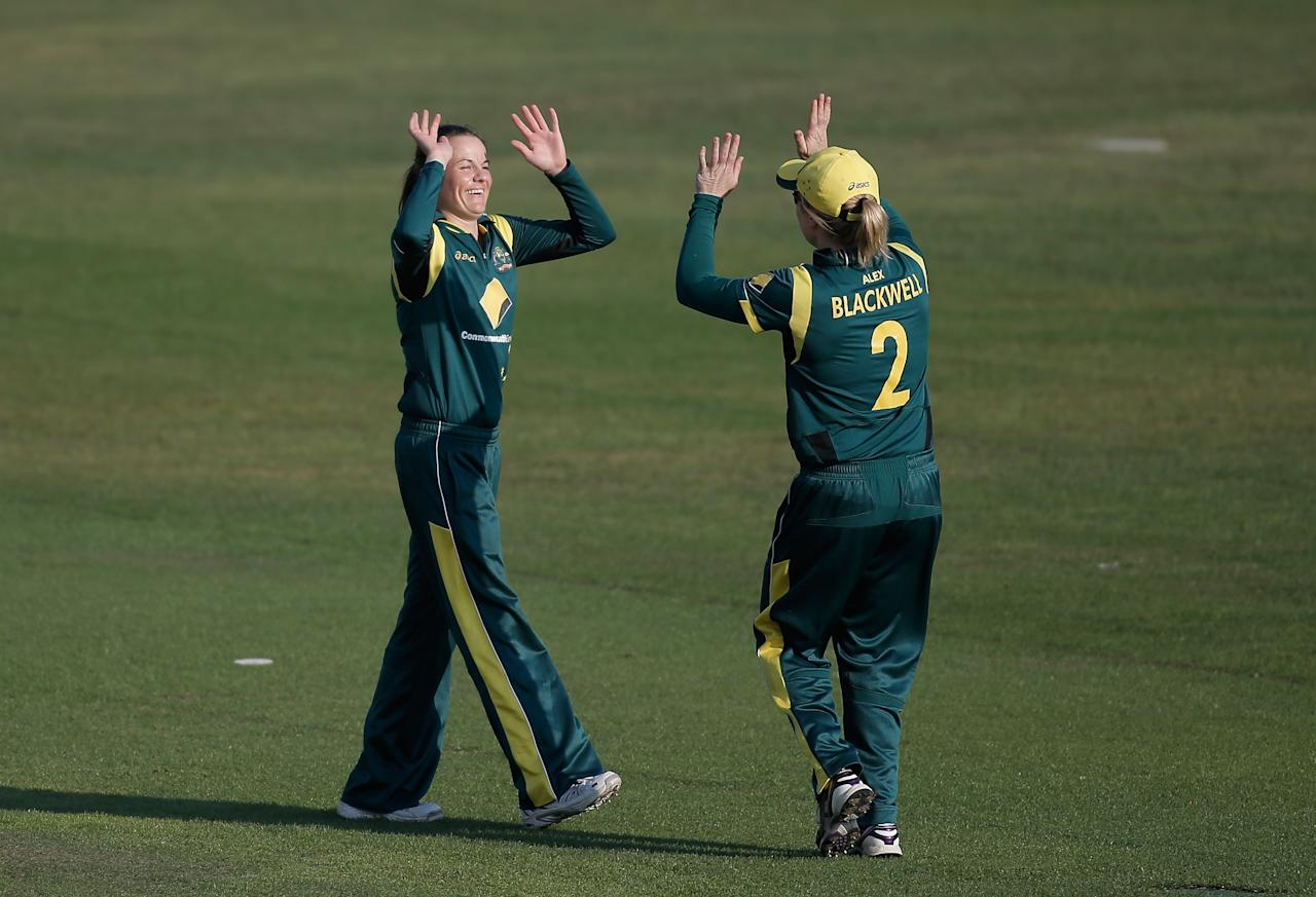 HOVE, ENGLAND - AUGUST 25: Erin Osborne of Australia (L) celebrates with teammate Alex Blackwell after dismissing Heather Knight of England (not pictured) during the third NatWest One Day International match between England and Australia at the BrightonandHoveJobs.com County Ground on August 25, 2013 in Hove, England.  (Photo by Harry Engels/Getty Images)