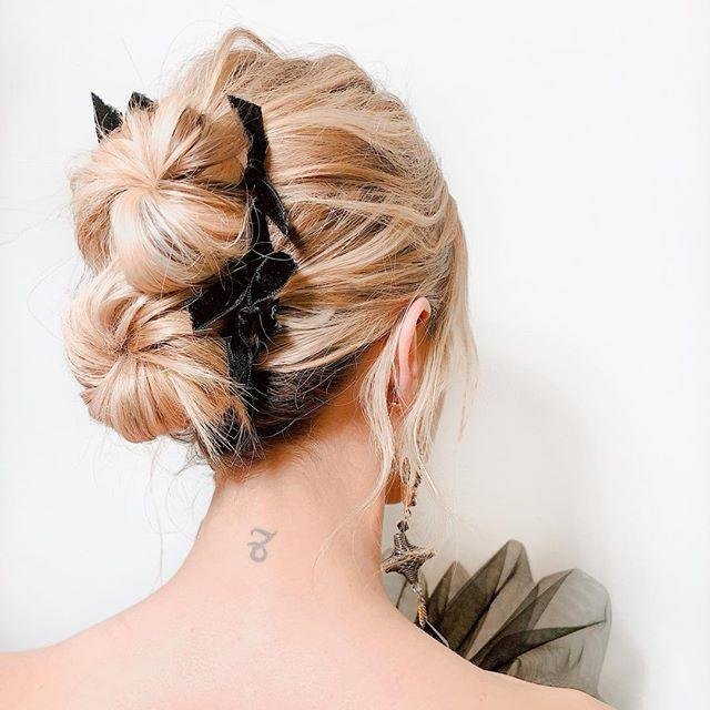 """<p><strong>The look: </strong>Double Buns</p><p>What's better than one messy donut bun? Two messy donut buns. To create a tousled texture, work a texturizing spray from roots to tips and style with a few face-framing tendrils. Before the wedding, just be sure to make a craft-store run and pick up some black velvet ribbon. Tie a few tiny bows and use bobby pins to secure them on your 'do.</p><p><strong>Try: </strong>Amika Un.Done Volume and Matte Texture Spray, $5; sephora.com</p><p><a class=""""body-btn-link"""" href=""""https://go.redirectingat.com?id=74968X1596630&url=https%3A%2F%2Fwww.sephora.com%2Fproduct%2Fun-done-texture-spray-P404913%3Ficid2%3Dproducts%2Bgrid%253Ap404913%253Aproduct&sref=http%3A%2F%2Fwww.elle.com%2Fbeauty%2Fhair%2Fnews%2Fg26002%2Fhair-inspiration-for-all-those-weddings-youll-be-attending%2F"""" target=""""_blank"""">SHOP NOW</a></p><p><a href=""""https://www.instagram.com/p/BvE4zKDH7Py/"""">See the original post on Instagram</a></p>"""