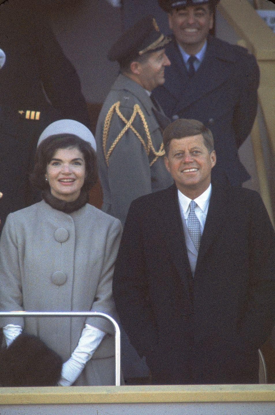 <p>Jackie Kennedy stands along side her husband at his inauguration. </p>