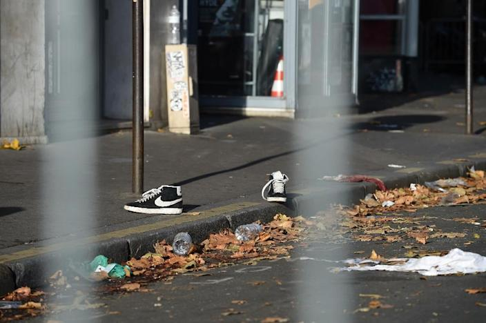 A pair of discarded shoes near the Bataclan concert hall, one of six targetted sites of the Paris attacks on November 13, 2015 (AFP Photo/Miguel Medina)
