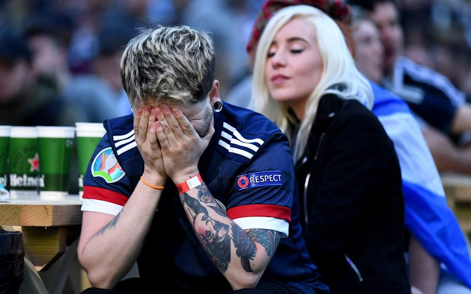 Scotland fans show their dejection as they support their team in the Euro 2020 game against Croatia on June 22, 2021 in Glasgow, Scotland. Scotland lost to Croatia, ending their Euro 2020 campaign. - GETTY IMAGES